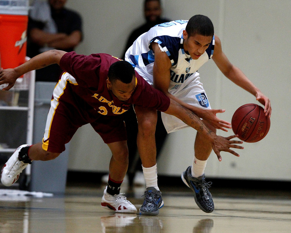 . Bellarmine College Preparatory\'s Blair Mendy (12) steals the ball away against Lincoln High School\'s Demetrius Williams (3) for their NorCal Division I Round 1 game in the first period at Bellarmine College Preparatory in San Jose, Calif., on Wednesday, March 6, 2013.  (Nhat V. Meyer/Staff)