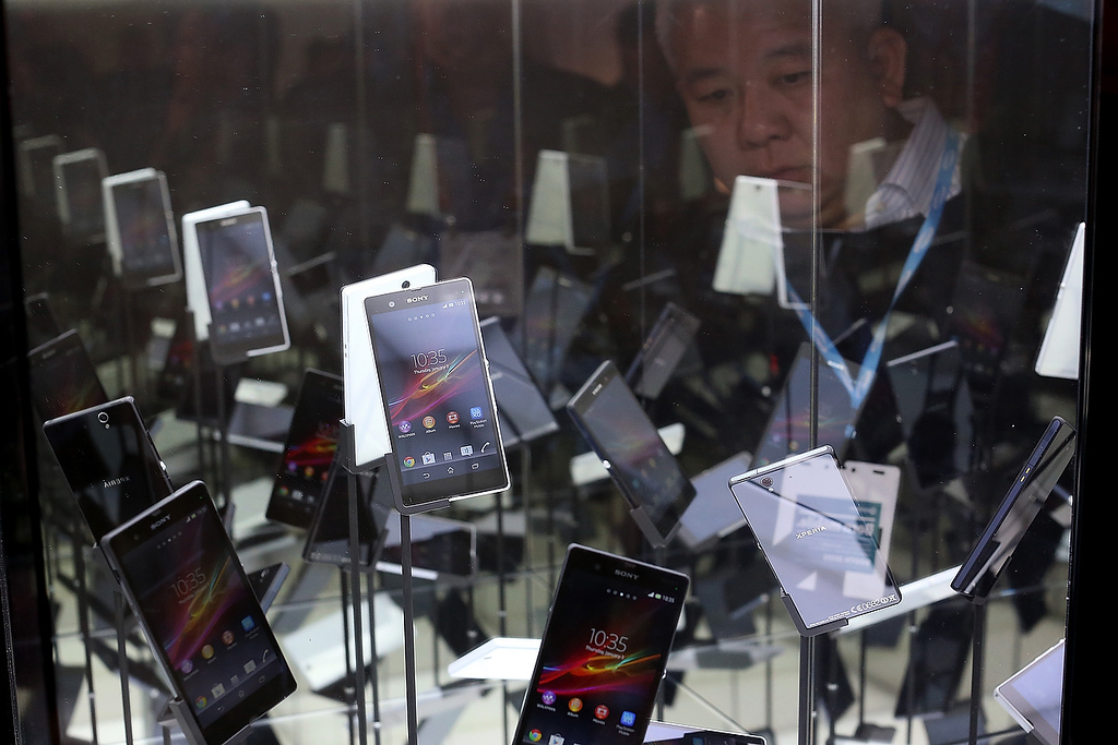 . An attendee views a display of Sony Xperia Z smart phones during the 2013 International CES at the Las Vegas Convention Center on January 8, 2013 in Las Vegas, Nevada. (Photo by Justin Sullivan/Getty Images)