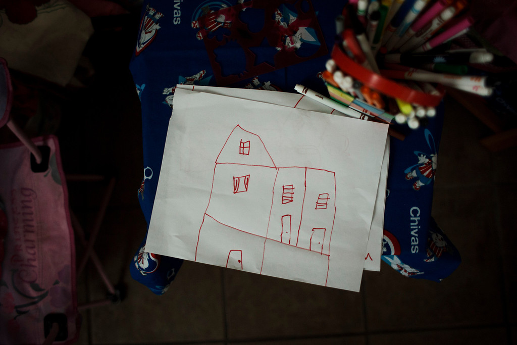 . A\'Riyah Jackson, 5, who lives in a mobile home in San Jose with her family, drew a picture of a house on May 24, 2013, in San Jose. (Dai Sugano/Bay Area News Group)