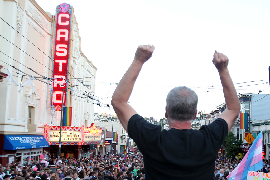 . Terry Martin, of Oakland, celebrates the Supreme Court\'s rulings on Proposition 8 and the Defense of Marriage Act in the Castro district in San Francisco, Calif., on Wednesday, June 26, 2013. (Ray Chavez/Bay Area News Group)