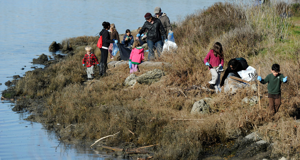 . Volunteers of all ages come together to honor Martin Luther King Jr. for a day of service at as they pick up trash and recyclables at Martin Luther King Jr. Shoreline Park  in Oakland, Calif., on Monday, Jan. 21, 2013. (Susan Tripp Pollard/Staff)