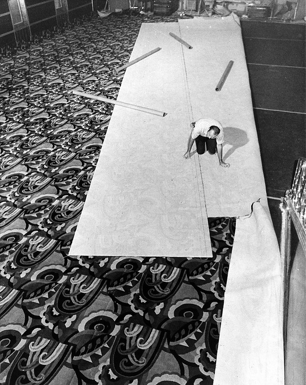 . Jack Hart lays new carpet in the main lobby at the Paramount Theatre in Oakland in 1973. Preservationists went to great lengths to make sure that new fixtures, such as carpet, were as close to the originals as possible. (Leo Cohen/Bay Area News Group Staff Archives)