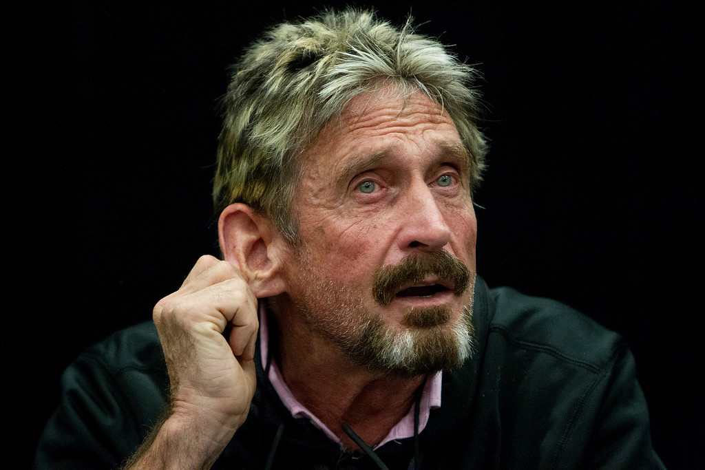 ". John McAfee listens to a question at the ""Fireside Chat with John McAfee\"" talk during the C2SV Technology Conference + Music Festival at the McEnery Convention Center in San Jose, Calif., on Saturday, Sept. 28, 2013.   (LiPo Ching/Bay Area News Group)"