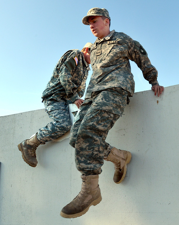 . Boy Scout Devin Nicholson of Oakley jumps from the top of a wall he just climbed over during an exercise at his battalion headquarters in Bethel Island, Calif., on Saturday Jan. 19, 2013. A group of eighteen boys are in a branch of the Boy Scouts know as Venturing. The East County club, the only Army-oriented one in northern California , not only gives kids a taste of military life but teaches them respect for authority, courtesy and self-confidence. (Dan Rosenstrauch/Staff)