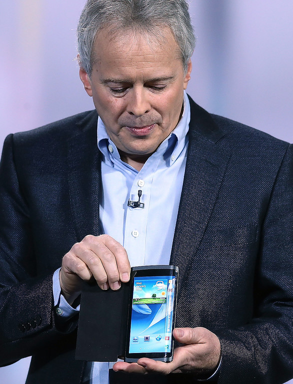 . Brian Berkeley, Samsung Electronics senior vice president of Samsung\'s display lab, shows a prototype of the YOUM Flexible display during a keynote address at the 2013 International CES at The Venetian on January 9, 2013 in Las Vegas, Nevada. (Photo by Justin Sullivan/Getty Images)