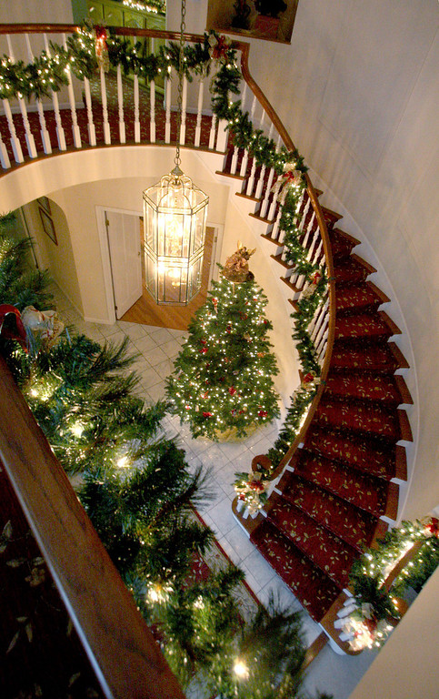 . The entry foyer is seen from above in Gladys Young\'s Danville, Calif., home on Wednesday, Nov. 28, 2012. She decorates many of the rooms with a variety of themes. (Jim Stevens/Staff)