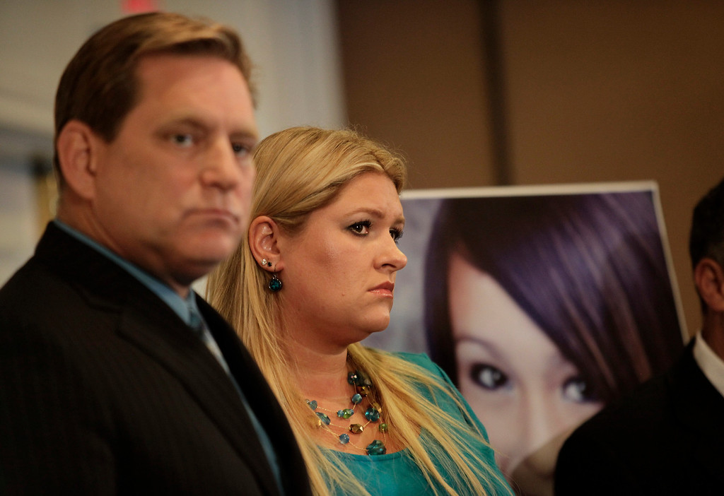 . Father Larry Pott and stepmother Lisa Pott  attend a news conference to talk about the tragic death of their daughter, Audrie Pott, in San Jose, Calif., on Monday, April 15, 2013. The 15-year-old Saratoga High School student committed suicide last September following an alleged sexual assault by three 16-year-old classmates. Photos of the assault were shared publicly prompting her to take her own life eight days later. (Gary Reyes/Bay Area News Group)