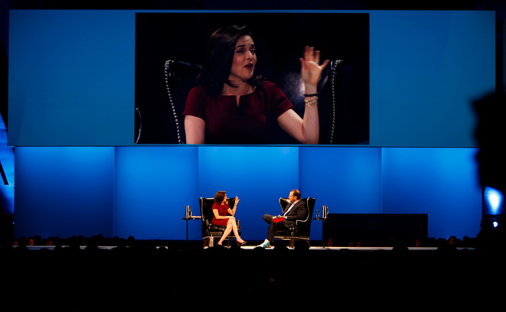 . Sheryl Sandberg, left, Facebook chief operating officer, talks to Marc Benioff, right, Salesforce.com CEO, during the Dreamforce Conference, the Salesforce annual conference, at the Moscone Center in San Francisco on Wednesday, Nov. 20, 2013.  (Nhat V. Meyer/Bay Area News Group)