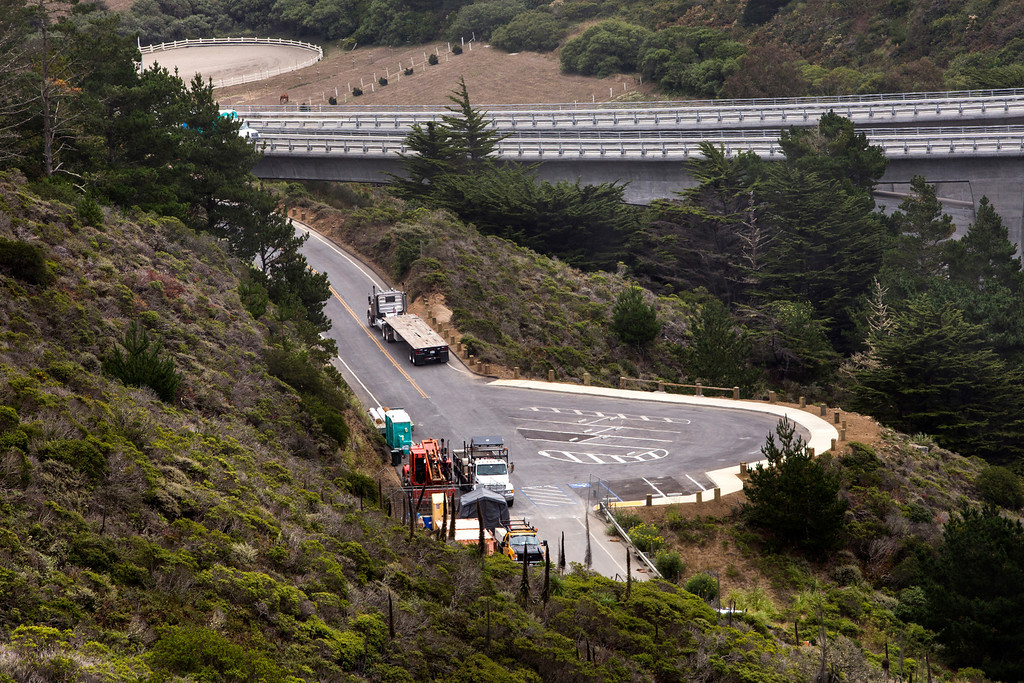 . Construction crews work on the parking lot for the new Devils Slide Trail near the north end of the Devils Slide Bypass Tunnels, south of Pacifica, Calif., on Tuesday, July 23, 2013. The project involves the conversion of a section of Highway 1 that was closed after the opening of the tunnels into a public multi-use nonmotorized trail.(John Green/Bay Area News Group)