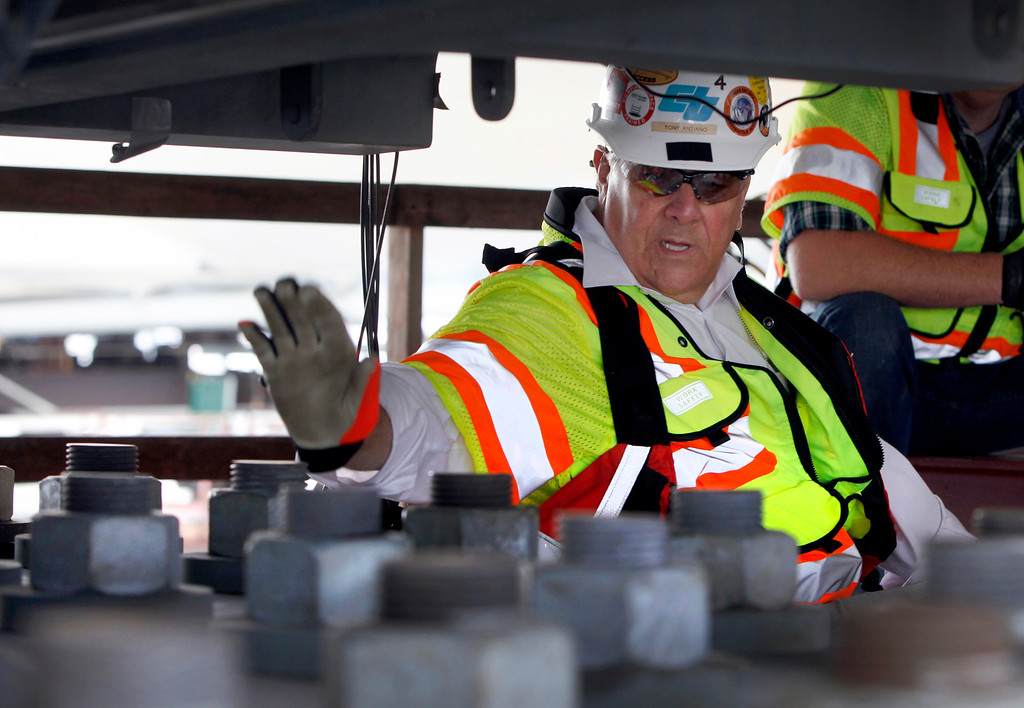 . Tony Anziano, Caltrans toll bridge program manager,  shows off anchor rods on the new Bay Bridge that are undergoing monitoring and testing Friday afternoon May 3, 2013. These rods have not failed like a different set of older hardware did on an adjacent shear key. (Karl Mondon/Bay Area News Group)