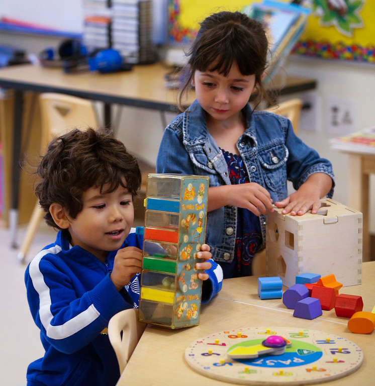 . Pre-kindergarten students play in one of the newly constructed Early Childhood Center classrooms at Charles House in San Mateo. (John Green/Bay Area News Group)(THE SHOOL DID NOT WANT KIDS NAMES USED)