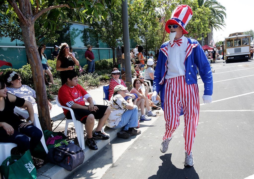 . Ken Adler of the Los Trancos Woods Community Marching Band entertains the crowd during the annual Fourth of July parade in Redwood City, Calif. on Thursday, July 4, 2013. Considered the largest Independence Day parade in Northern California, it is celebrating its 75th year. (Gary Reyes/Bay Area News Group)