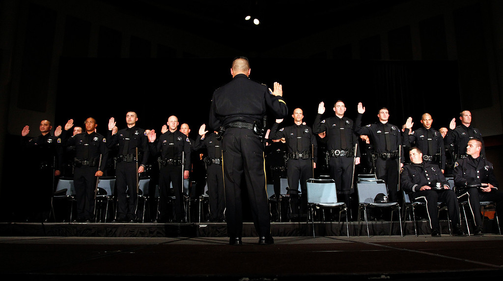 . Chief of Police Larry Esquivel performs the presentation of badges and oath of office at the San Jose Police Academy graduation in San Jose, Calif. on Friday, March 15, 2013.   (LiPo Ching/Staff)
