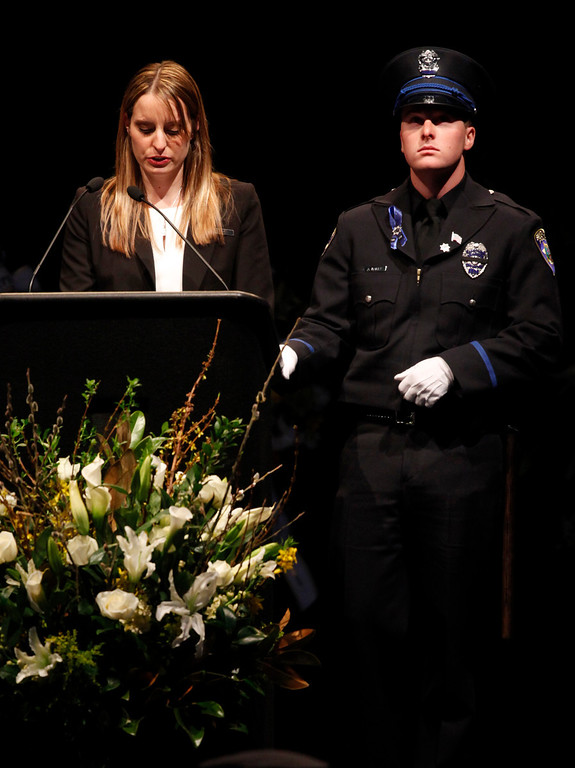 ". Jillian Baker, standing alongside her brother Adam Baker, eulogizes her father, Santa Cruz police Sgt. ""Butch\"" Baker during memorial services at the HP Pavilion on Thursday, March 7, 2013 in San Jose, Calif.  (Karl Mondon/Staff)"