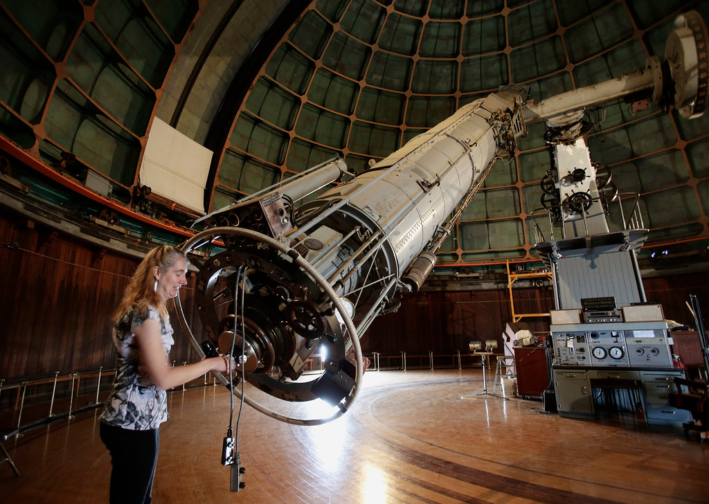 """. Astronomer Elinor Gates installs a viewfinder at the rear of the 36\"""" Refractor telescope at Lick Observatory east of San Jose, Calif. on May 8, 2013. The observatory will be celebrating its 125th anniversary.  (Gary Reyes/ Bay Area News Group)"""