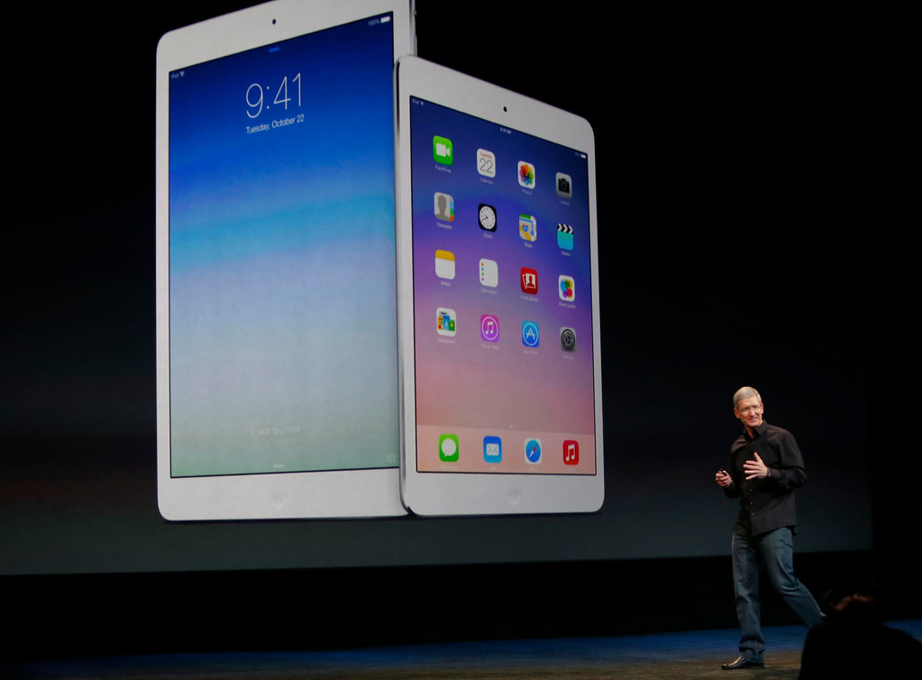 ". Apple CEO Tim Cook announced a release of new iPad models Tuesday morning, Oct. 22, 2013 in San Francisco, Calif., including the iPad Air, a thinner and lighter 10-inch tablet, and a new iPad Mini with a high-definition ""Retina\"" display.  (Karl Mondon/Bay Area News Group)"