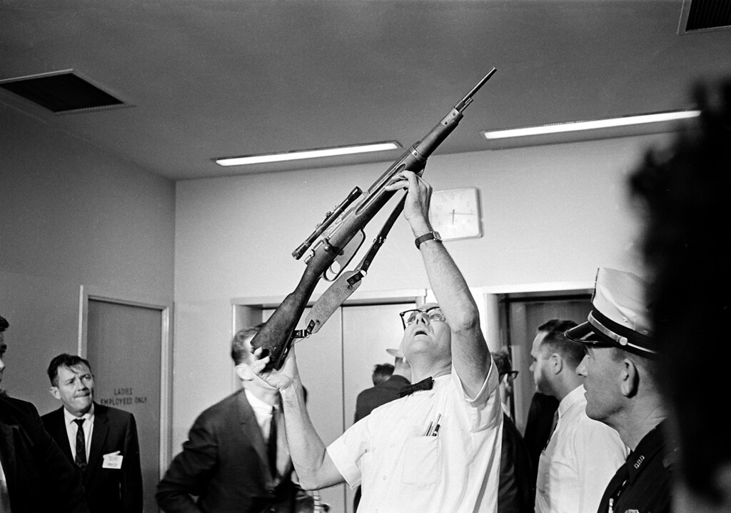 . Police Lt. J.C. Day holds aloft the bolt-action rifle with telescopic sight which was allegedly used in the assassination of U.S. President John F. Kennedy, Dallas, Texas, on November 22, 1963.  (AP Photo)