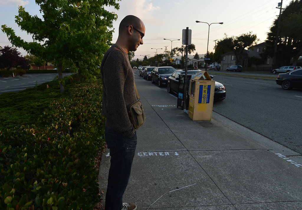 . On day 2 of the BART strike, first-time casual carpooler Ben Sadeghi waits for a Civic Center bound ride at the North Berkeley BART station in Berkeley, Calif. on Tuesday, July 2, 2013. (Kristopher Skinner/Bay Area News Group)