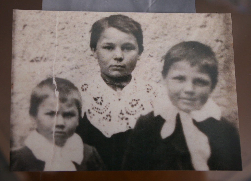 . Evelyne Pothron\'s mother Alice Guyonvernier (maiden name) is seen in a photograph with her brothers Gaston, left, and Henri at her home in Alameda, Calif., on Thursday, Jan. 24, 2013. Gaston was killed in an orphanage in France.  (Jane Tyska/Staff)