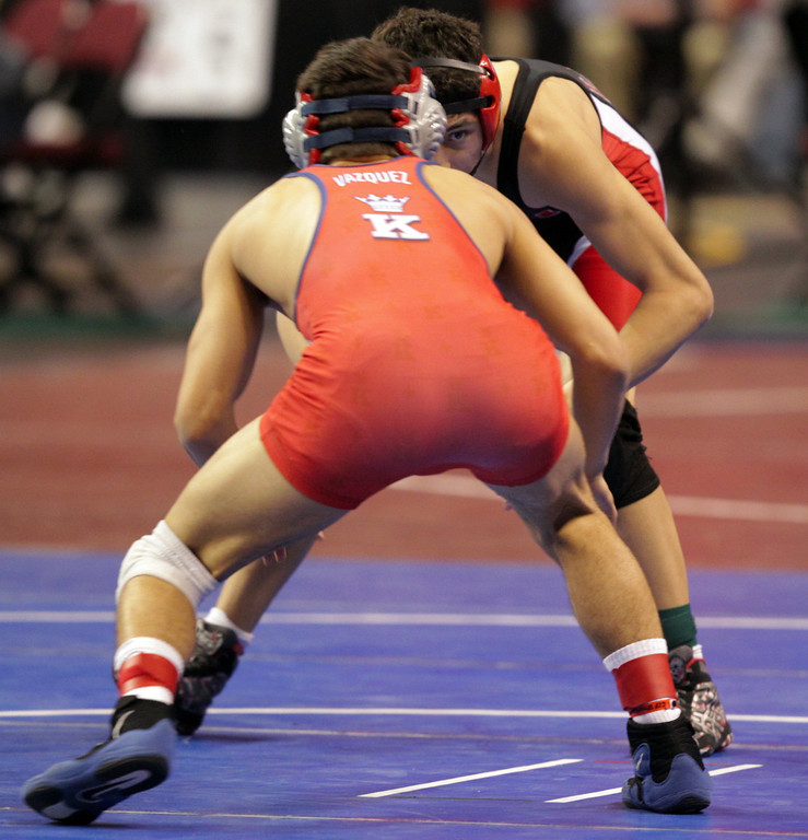 . James Logan\'s Artemio Flores, right, faces off against King\'s Christian Vasquez in a 126-pound second round match during the California Interscholastic Federation wrestling championships in Bakersfield, Calif., on Friday, March 1, 2013. Flores would go on to win. (Anda Chu/Staff)