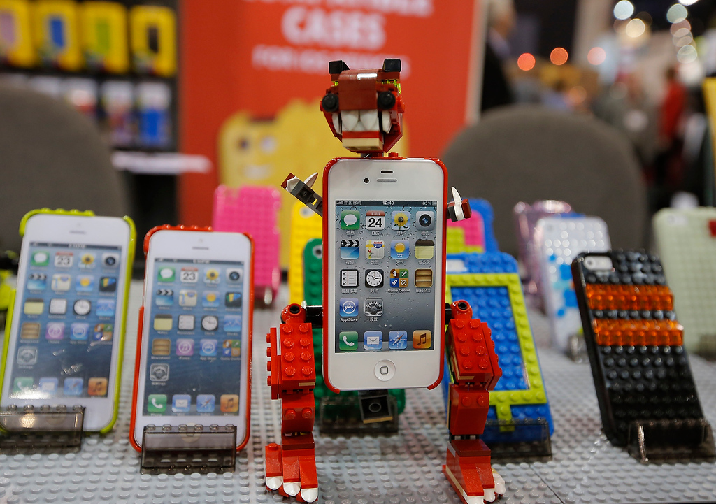. SmallWorks\' LEGO compatible iPhone cases are shown at the International Consumer Electronics Show in Las Vegas, Wednesday, Jan. 9, 2013. (AP Photo/Jae C. Hong)