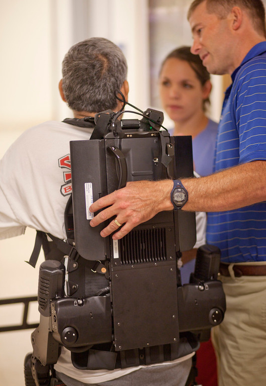 ". Richard Torres of Livingston uses ""Ekso\"" a robotic exoskeleton device at the Rehabilitation Center at Santa Clara Valley Medical Center in San Jose Wednesday, July 17, 2013.  (Patrick Tehan/Staff)"