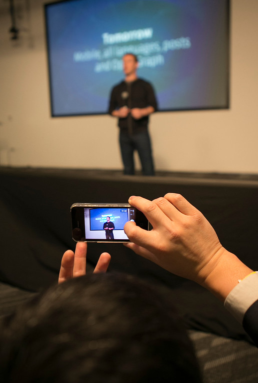 . A member of the media films Mark Zuckerberg announcing Graph Search during a press conference at Facebook in Menlo Park, Calif., on Tuesday, Jan. 15, 2013. (John Green/Staff)