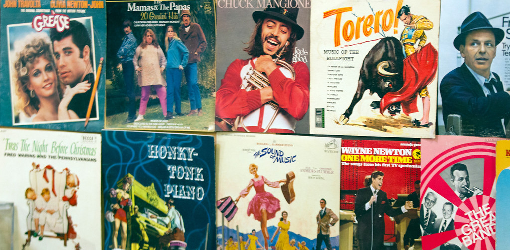 . Covers of vinyl records decorate the wall of the audio recording section of the annual White Elephant Sale, at the Oakland Museum Women\'s Board 96,000-square-foot warehouse in Oakland, Calif., Tuesday, Jan. 15, 2013. (D. Ross Cameron/Staff)
