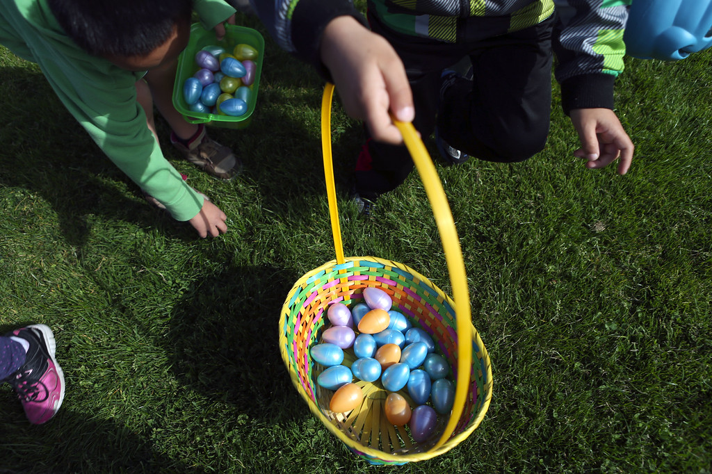 . Kids snatch up plastic Easter eggs at the annual San Leandro Easter egg egg hunt held at Marina Park in San Leandro, Calif., Saturday, April 12, 2014. The event has been held every year since 1951 and this year is sponsored by the San Leandro Optimist Club. 8,000 eggs with a candy or sticker surprise were given away. (Anda Chu/Bay Area News Group)