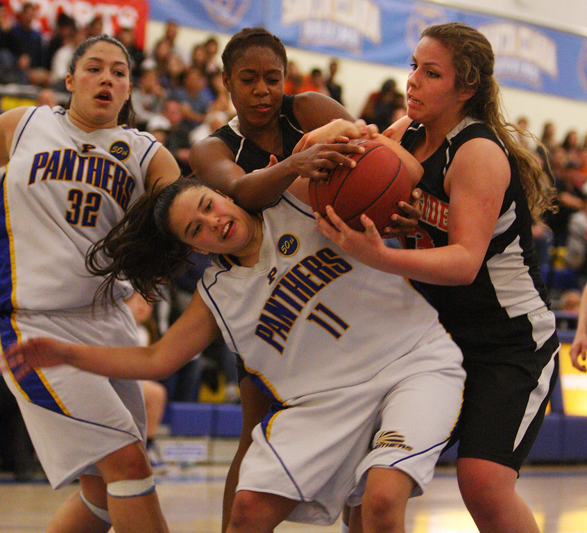 . Presentation\'s Courtney Danna fights for a rebound with Woodside\'s Sharnon Lionel and Madison Michelis in the third quarter during the CCS Division II girls basketball finals at Santa Clara High School in Santa Clara, Calif. on Friday, March 1, 2013. The Presentation Panthers beat the Woodside Wildcats, 49-34. (Jim Gensheimer/Staff)