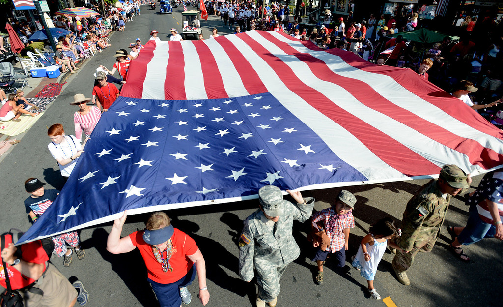 . A large flag from the Martinez, based Daughters of the American Revolution is carried down Hartz Avenue during the Danville\'s 4th of July Parade in Danville, Calif., on Thursday, July 4, 2013. The parade, sponsored by the Kiwanis Club of San Ramon Valley, features about 120 entries with an estimated 40,000 spectators attending. (Doug Duran/Bay Area News Group)