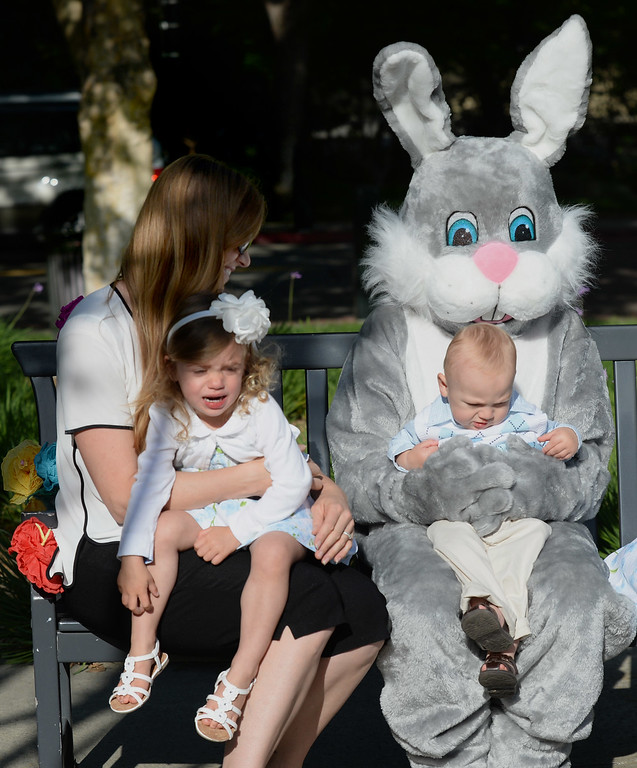 """. While Teddy Sentinella, 1, of Danville, sits on the Easter Bunny\'s lap while is sister Molly Sentinella, 2, is seen to the left with her mother, who did not wish to be identified, during the Town of Danville\'s \""""Eggstravaganza\"""" held at the Danville Community Center in Danville, Calif., on Saturday, April 12, 2014. The event featured egg hunts for children of all ages as well as fun activities and snacks. (Dan Honda/Bay Area News Group)"""