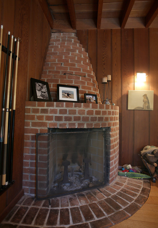 . A fireplace is seen inside a remodeled 1937 one-bedroom cabin is seen on Woodmont Avenue in Berkeley, Calif., on Thursday, July 25, 2013.  Architect Gustave Carlson, of Gustave Carlson Design in Berkeley, managed the project. (Jane Tyska/Bay Area News Group)