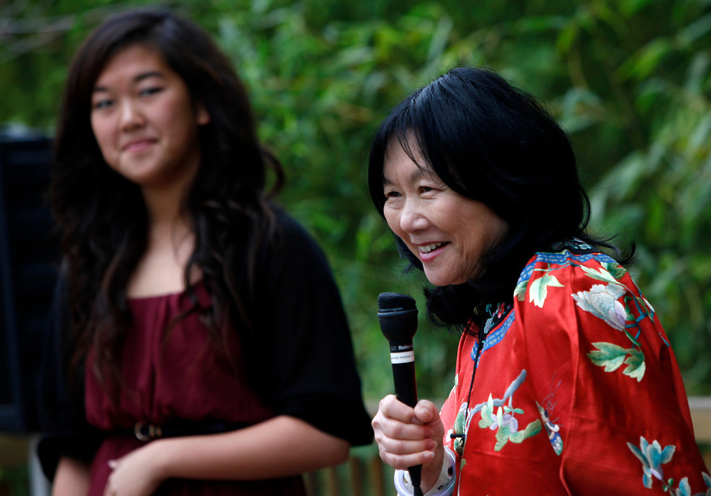 ". Connie Young Yu, the president of the nearly century-old Hakone Estate and Gardens, introduces zitherist Jennifer Liu at the Lunar New Year of the Snake festival and ""Chinese Village Fair\"" on Sunday afternoon, March 3, 2013 in Saratoga, Calif. (Karl Mondon/Staff)"