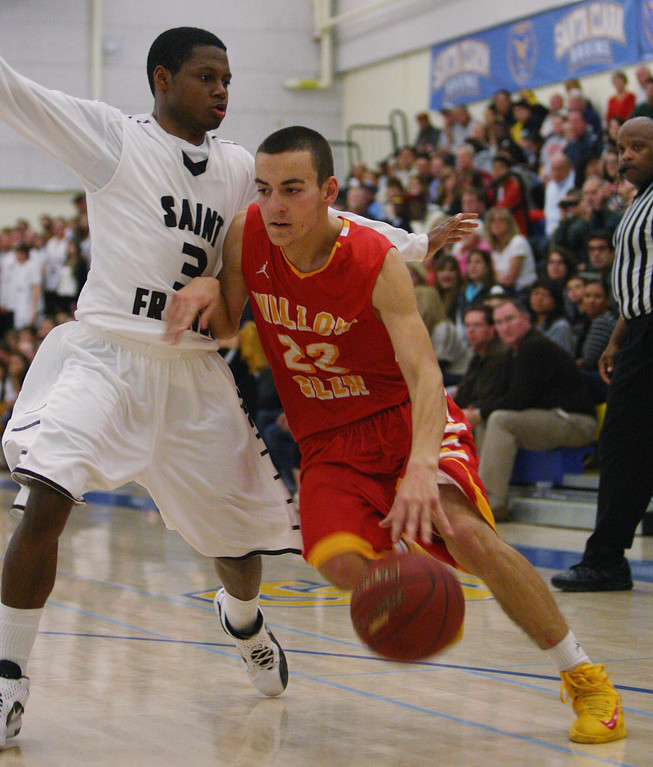 . Willow Glen\'s Rj McCune drives in on St. Francis\' Khalid Johnson in the fourth quarter during the CCS Division II boys basketball finals at Santa Clara High School in Santa Clara, Calif. on Friday, March 1, 2013. The Saint Francis Lancers beat the Willow Glen Rams, 56-46. (Jim Gensheimer/Staff)