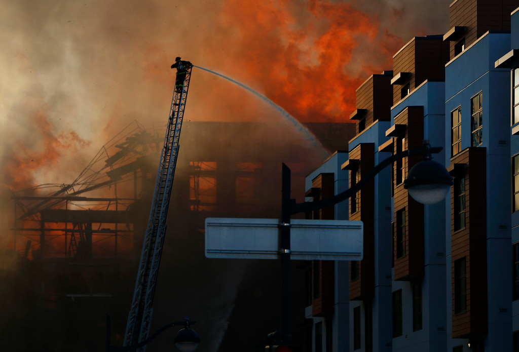 . Firefighters battle a multi-alarm blaze in a residential building under construction in the Mission Bay neighborhood of San Francisco, Calif., Tuesday evening March 11, 2014. (Karl Mondon/Bay Area News Group)