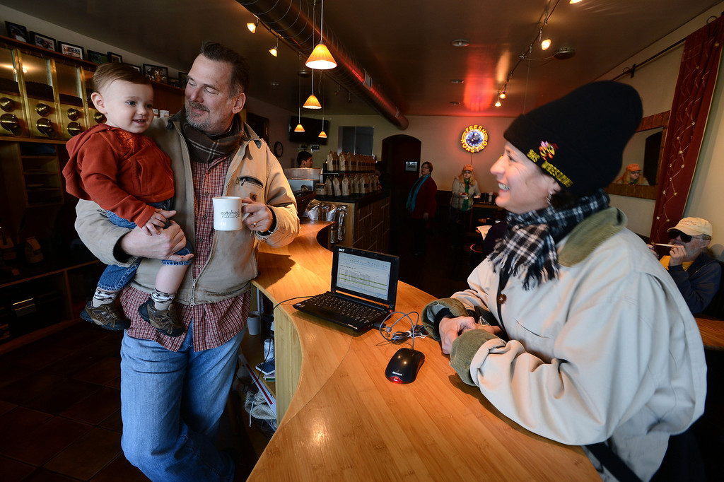 . Regular customer Sherry LaVars gets a smile out of Catahoula Coffee Company owner Tim Manhart\'s 14-month-old son Nicholas at the coffee shop in Richmond, Calif. on Thursday, Jan. 17, 2013. (Kristopher Skinner/Staff)