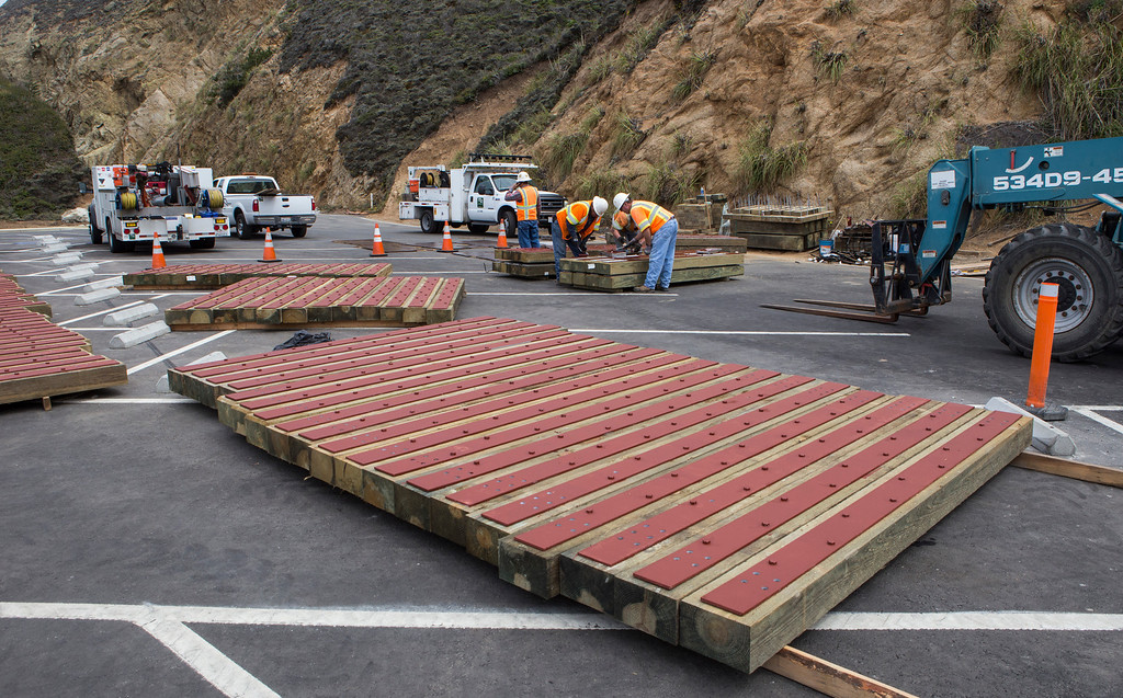 . Construction crews work on fence posts for the parking lot view area on the south end of the Devils Slide Tunnel on Tuesday, July 23, 2013. (John Green/Bay Area News Group)
