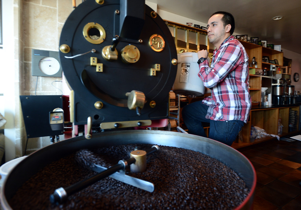 . Catahoula Coffee Company roaster Alfredo Zambrano roasts a batch of Lola blend at the shop in Richmond, Calif. on Thursday, Jan. 17, 2013. (Kristopher Skinner/Staff)