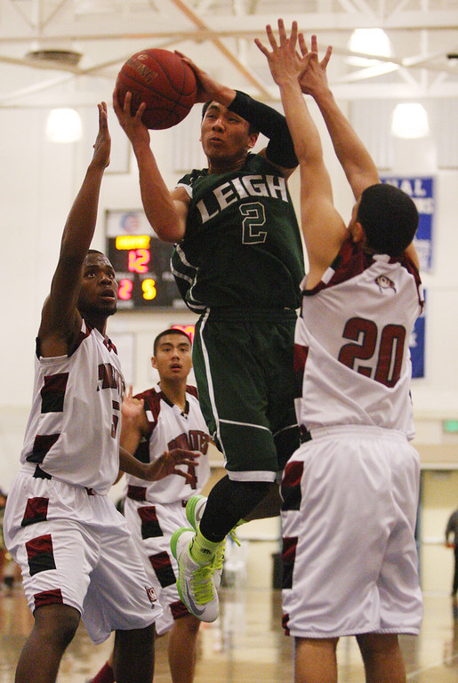 . Leigh\'s Kimo Francisco shoots on Piedmont Hills\' Rey Lowe in the first quarter during the Blossom Valley Athletic League boys basketball championship game at Independence High School in San Jose, Calif. on Friday, Feb. 15, 2013. (Jim Gensheimer/Staff)