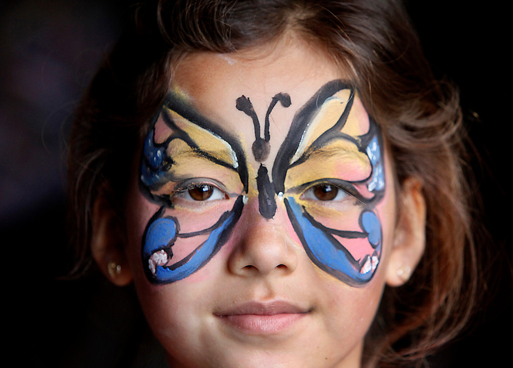 ". Seven-year-old Zoe Nguyen shows off her butterfly face paint at Hakone Estate and Gardens Lunar New Year of the Snake festival with a ""Chinese Village Fair\"" on Sunday afternoon, March 3, 2013 in Saratoga, Calif. (Karl Mondon/Staff)"
