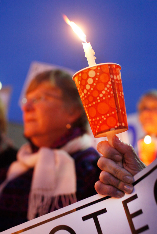 """. Demonstrators hold candles during a vigil in Lytton Plaza in downtown Palo Alto supporting an end to gun violence on Friday, Feb. 22, 2013. About 100 people attended the vigil. Organizing for Action: Silicon Valley sponsored the vigil as part of a national grassroots day of action against gun violence and to rally support for new gun control laws. �Our society is suffering from this horrible devastation of gun violence. It\'s not only the victims but the whole community and families,\"""" said Bonnie Bernstein, with Silicon Valley Community Against Gun Violence. (Kirstina Sangsahachart/ Daily News)"""