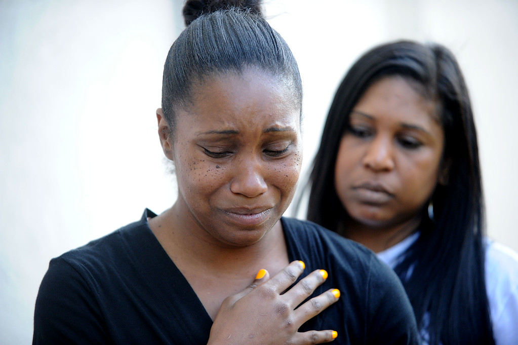 . Brea Colbert, left, takes a moment to compose herself as she talks to reporters with her sister Raquel Suarez, of San Leandro, at her side in Oakland, Calif., on Saturday, July 20, 2013. Colbert\'s two children were shot and wounded and their friend Alaysha Carradine, 8, was killed when a gunman fired multiple shots into the apartment after Alaysha\'s friend opened the front door at 11:18 p.m. on Wednesday, July 17. No arrests have been made in the case. (Doug Duran/Bay Area News Group)