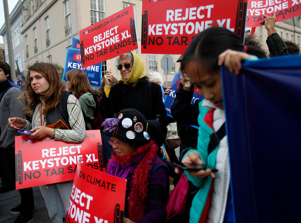. Protesters at the intersection of Pacific Avenue and Baker Street rally against the plan to build a pipeline from Canada to Texas, called the Keystone XL pipeline, in Pacific Heights in San Francisco, Calif., on Wednesday, April 3, 2013.  (Nhat V. Meyer/Staff)
