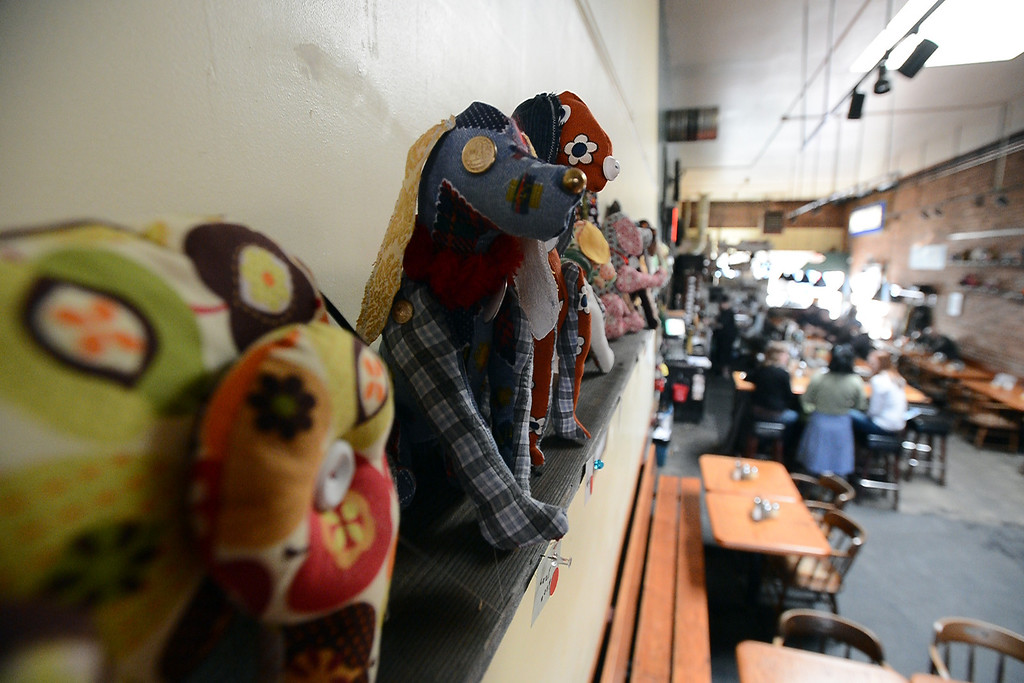 . Scrapyard Dogs, created by Madeline Stanionis and Alice Worland to raise money for local charities, are on display at the Lanesplitter Pizza location in Berkeley, Calif. on Monday, Jan. 28, 2013. (Kristopher Skinner/Staff)
