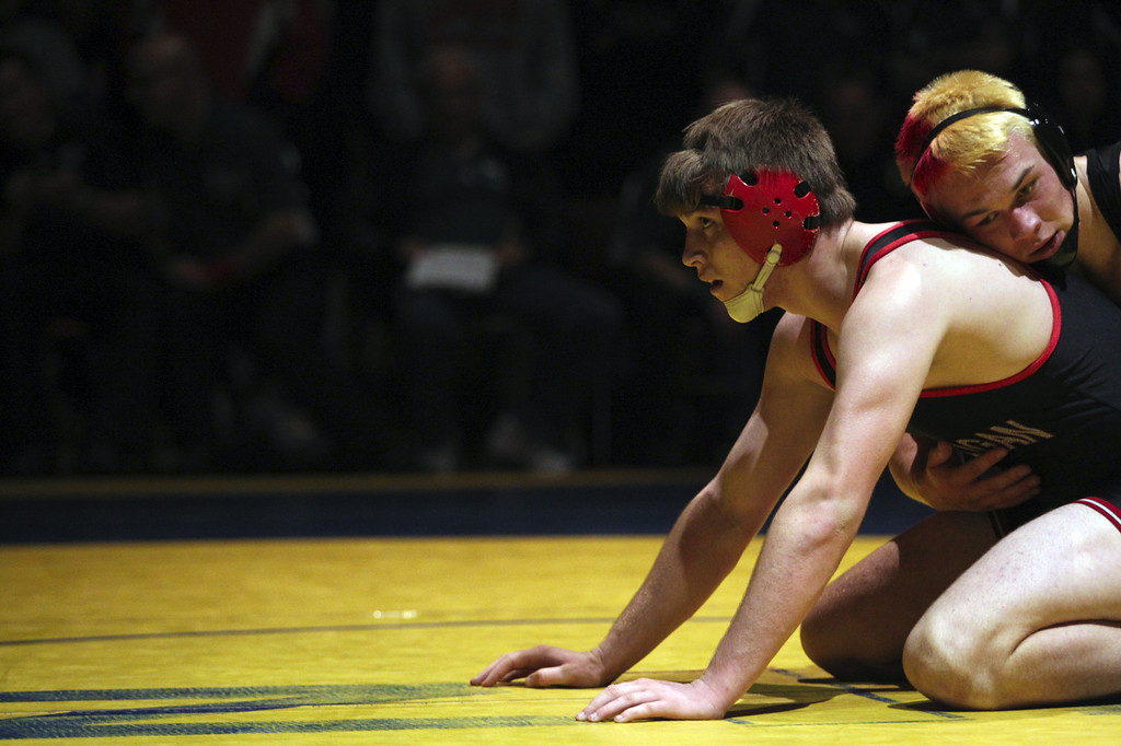 . James Logan\'s Clayton Hartwell, left, faces off against McKinleyville\'s Jason Price in the 195-pound finals at the North Coast Section wrestling championships held at Newark Memorial High School in Newark, Calif., on Saturday, Feb. 23, 2013. Hartwell would get the win. (Anda Chu/Staff)