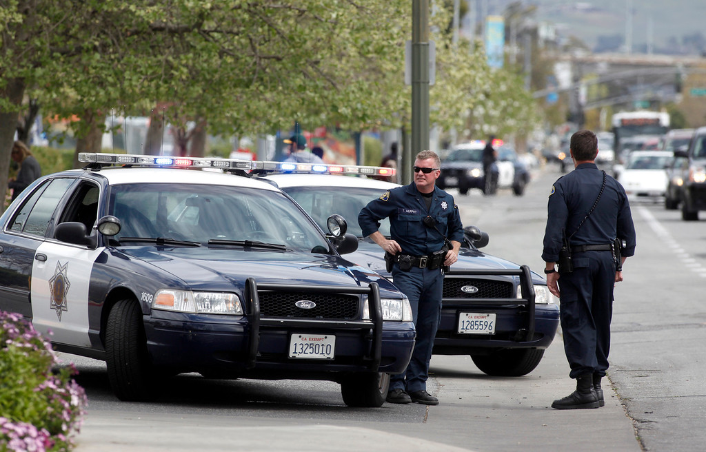 . Police close off the entrance to the Walmart on Story Road in San Jose, Calif., where a vehicle drove into the building and a driver reportedly began assaulting people in the store on Sunday, March 31, 2013. Traffic on Story Road was nearly gridlock. (Karl Mondon/Staff)