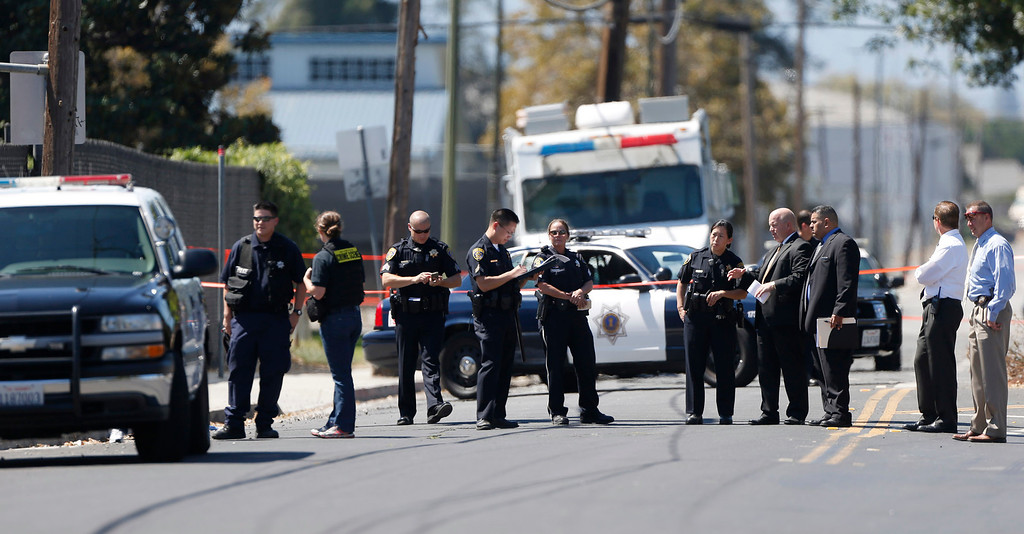. San Jose Police and San Jose State University police investigate San Jose\'s 37th homicide as they gather in the middle of Humbolt Street near the tennis court parking lot at  San Jose State University, in San Jose Calif., on Sunday, Sept. 8, 2013 (Josie Lepe/Bay Area News Group)