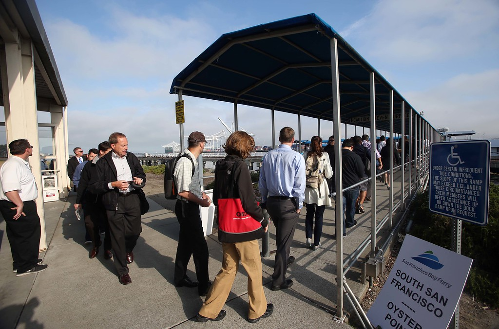 . Commuters board the San Francisco Bay Ferry at the terminal in Alameda, Calif., on Wednesday, July 3, 2013. The BART strike is in its third day and bargaining talks will resume at 1 p.m. Wednesday. (Jane Tyska/Bay Area News Group)
