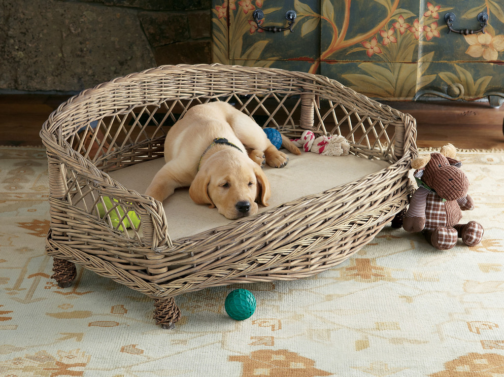 . A wicker dog bed is part of a new line of high-end pet furniture offered by Soft Surroundings. Beds sell for $99.95 to $178.95. Courtesy of Soft Surroundings